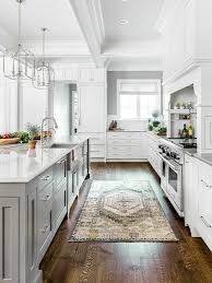 Large transitional kitchen ideas - Inspiration for a large transitional  brown floor and dark wood floor