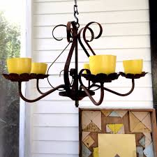 re purposed rusty chandelier to front citronella candle holder