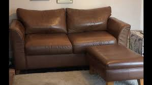 real leather sofa bed and footstool 1 of 4