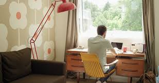 retro home office. Rear View Man Working At Desk Using Smartphone Tablet In Retro Trendy Home Office Leaning Back Drinking Coffee Stock Video Footage - Videoblocks