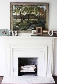 birch logs stacked in fireplace beautiful alternative to faux logs in a gas fireplace