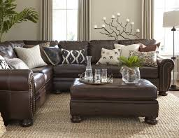 Leather with cotton and burlap will create contrast and style. Dark couch  with light cushions