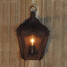 furniture rustic brown iron carriage wall lantern indooroutdoor coastal outdoor wrought lighting lanterns 944be5f61beccf96524cda3231115970 rust