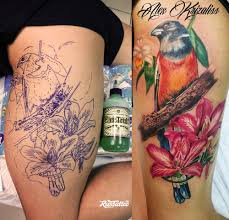 фото татуировки птица с цветами в стиле реализм татуировки на