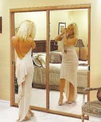 mirrored closet doors. Lady In Front Of Mirror Mirrored Closet Doors
