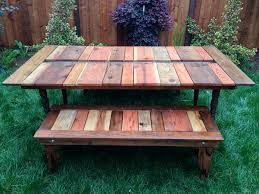 picture of reclaimed wood flat pack picnic table with planter ice trough