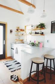 I love the light in the kitchen, pops of color and contrasting paint make a