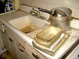 kitchen sink needing refinishing