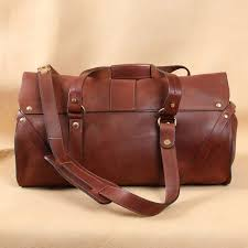 leather travel bag back side plain with brown leather carry strap
