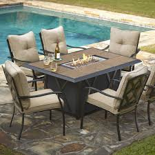 stunning dining table with fire pit