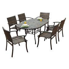 Shop stone harbor oval dining table and newport arm chairs 7 piece outdoor dining set by home styles free shipping today overstock 6695044