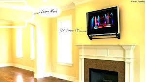 hanging tv above fireplace mounting above fireplace