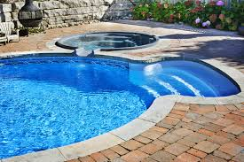 outdoor in ground residential swimming pool in backyard with hot