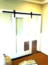 frosted glass sliding barn door with bathroom