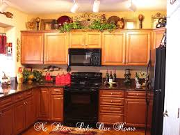 brown rectangle contemporary wooden kitchen cabinets top decorating ideas varnished ideas for top of