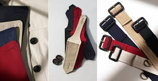 the trench waist belt as well as the epaulettes burberry trenchcoat navy blue red