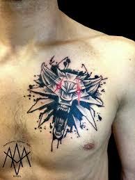 цветная тату на спину голову руку в тематике тату по игре ведьмак