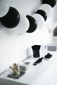 Black and White Birthday Party Idea. I like the alternating black and white  balloons.