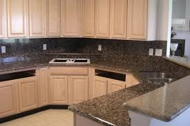 granite backsplash with granite countertops with granite countertops white cabinets
