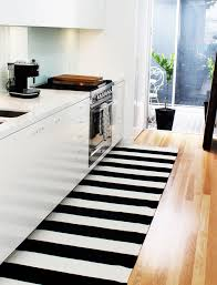 fashionable big kitchen flooring rug design with comely black and white striped color design under trendy white cabinet ideas