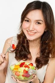 Asian woman eat salad