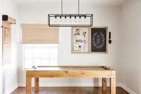 rectangular box frame chandelier over blond oak pool table