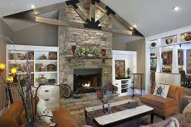 living room with stone fireplace. eclectic living room with high ceiling stone fireplace zillow r