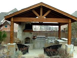 stone outdoor kitchen classy brown color engaging wooden pergola astounding brown color wooden outdoor kitchen