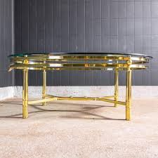 midcentury brass coffee table with oval