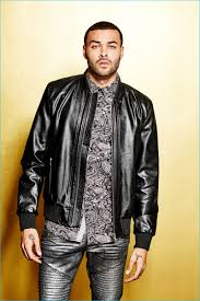 front and center don benjamin rocks a leather jacket with gold skinny moto jeans