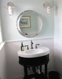 Port Hole mirror and rainwashed sherwin williams paint color on bathroom  walls.