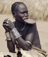 a mursi woman wearing a large clay lip