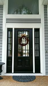 model 440 signet fiberglass front entry door coal black with aged bronze finish hardwareinterior doors painted