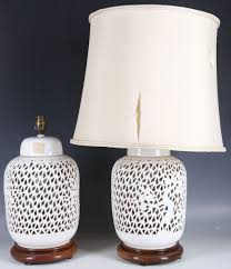 lot 35 a pair of 1950s chinese porcelain blanc de chine lamp bases having