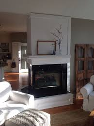 three sided fireplace with mantle
