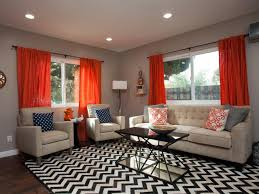 mesmerizing living room in chevron accent featuring orange sheer curtains and stylish contemporary table