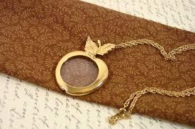 avon apple magnifying glass pendant