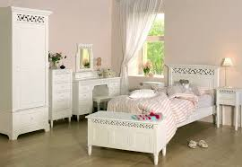 white bedroom furniture sets for girls modern design with beautiful table lamp wood desk and cupboard hardwood laminate flooring pink wall painting color beautiful white bedroom furniture
