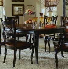 dining table that seats 10: awaken your senses with this dining table and its details that make a dramatic statement it is crafted from hardwood solids with cherry mahogany and white