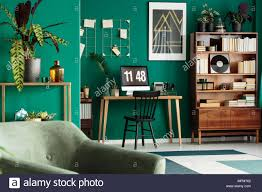 office desk in living room. Contemporary Office Hipster Home Office Desk With Desktop Computer And An Antique Wooden  Bookcase In A Green Designer Living Room Interior Plants And Office Desk In Living Room