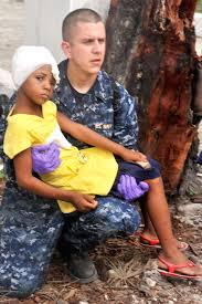 u s department of defense photo essay  u s navy lt marlin williams holds an injured an girl as he waits for
