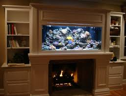 An aquarium next to the fireplace in the living room, is good feng shui?