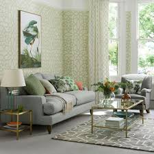 modern green living room with fretwork wallpaper and grey sofa