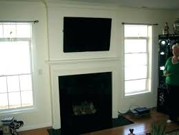 over mantle wood burning fireplace television above below mantels mounted tv mantel ideas