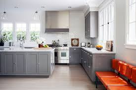 gray natural light kitchen ideas gray kitchen cabinet glass pendant lights brown chair white tiled kitchen backsplash