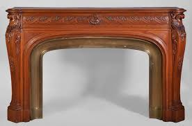 large antique napoléon iii style fireplace made out of carved oak with brass insert