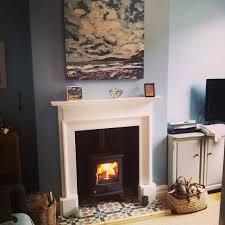 lounge wood burner painted mantelpiece and tiled hearth