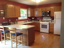 image of what color hardwood floor with oak cabinets ad lighting