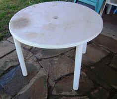 refinish an old cheap plastic outdoor table with an any surface metalic spray paint for a cheap plastic patio furniture