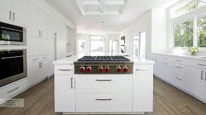 modern white kitchen cabinets with omega cabinetry